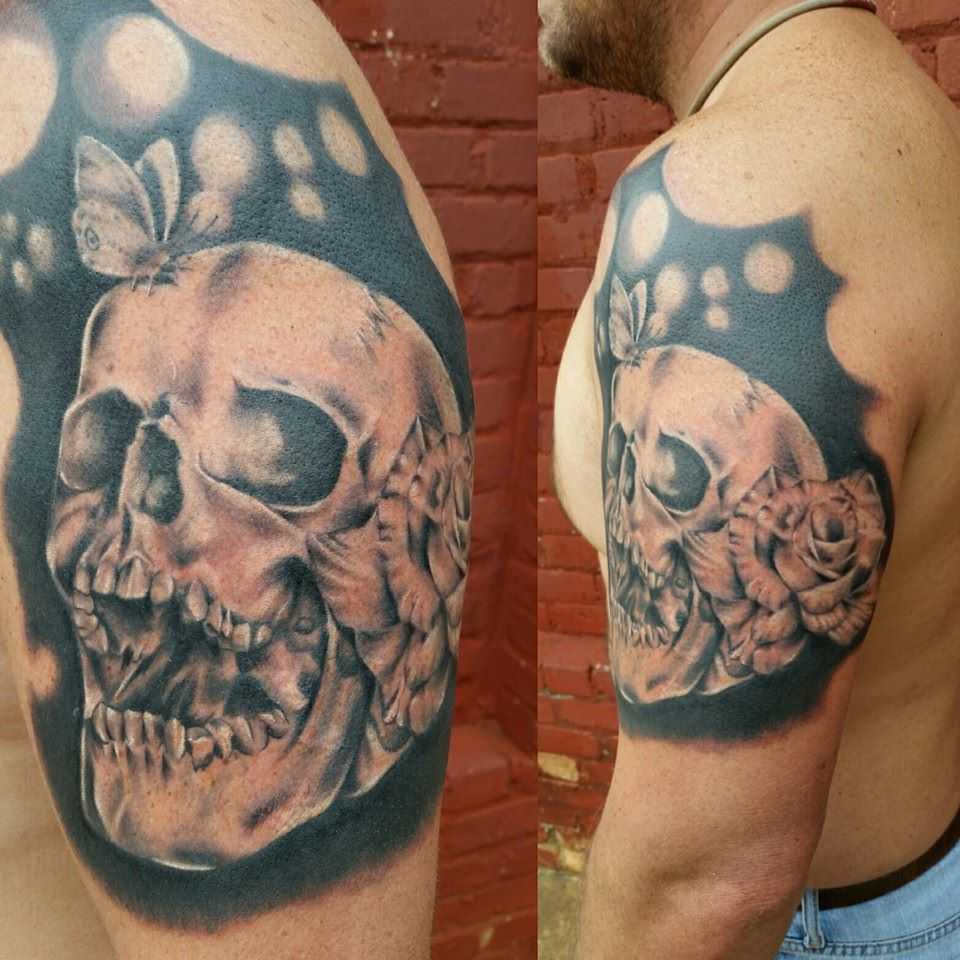 Black and gray skull and flower half sleeve by Chico lou's Fine Tattoos in Athens Georgia GA