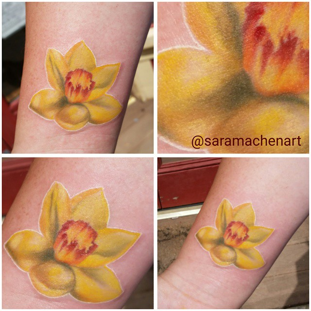 Realistic color daffodil by Chico Lou's Fine Tattoos in Athens GA