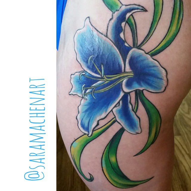 Color flower by Chico Lou's Fine Tattoos in Athens, GA