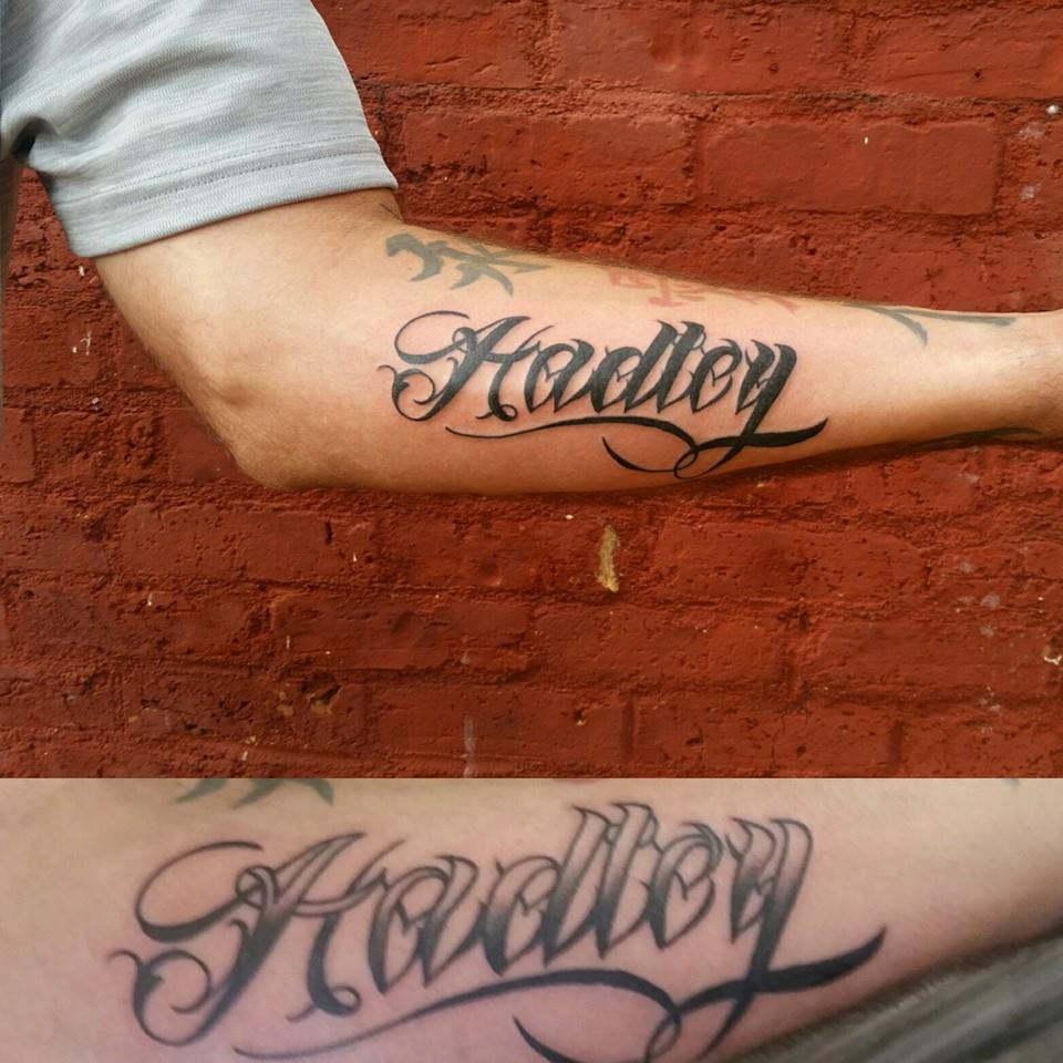 A script name fixup by Chico Lou's Fine Tattoos in Athens, GA