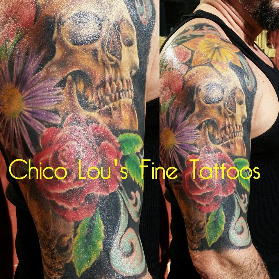 Color flowers and skulls by Chico Lou's Fine Tattoos in Athens Georgia GA. Artist - Sara Fogle