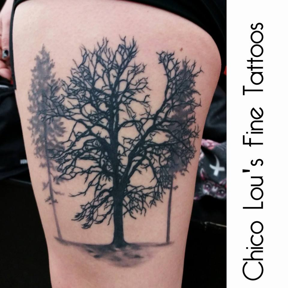 Finished tree silhouette by Chico Lou's Fine Tattoos shop in Athens Georgia GA. Artist - Sara Fogle