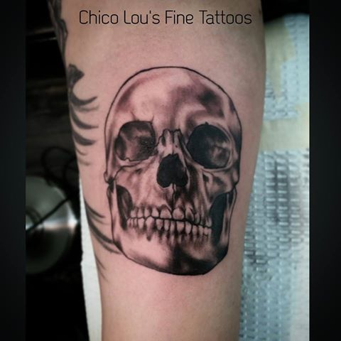 Black and gray skull by Chico Lou's Fine Tattoos shop in Athens Georgia GA. Artist - Sara Fogle