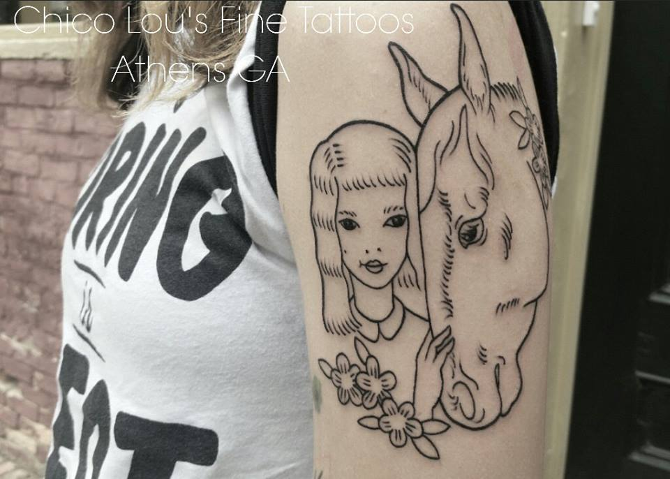 A girl and her horse by Chico Lou's Fine Tattoos shop in Athens Georgia GA. Artist - Sara Fogle