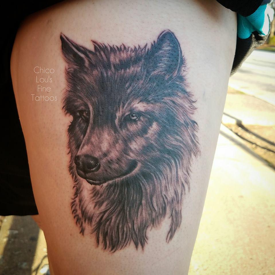 Wolf dog by Chico Lou's Fine Tattoos shop in Athens Georgia GA. Artist - Sara Fogle
