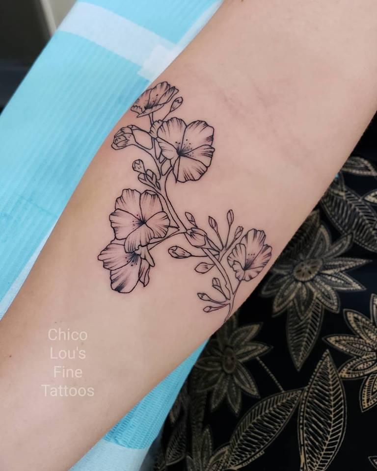 Cherry blossom by Chico Lou's Fine Tattoos shop in Athens Georgia GA. Artist - Sara Fogle