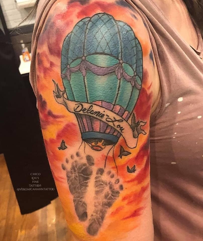 Hot air ballon and footprints by Chico Lou's Fine tattoos shop in Athens Georgia GA. Artist - Veronica Hahn