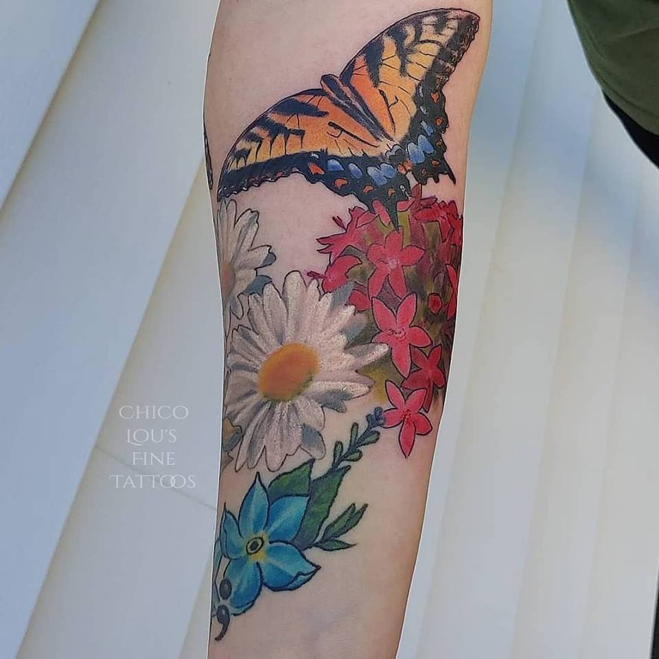 Butterfly and flowers by Chico Lou's Fine Tattoos studio in Athens Georgia GA. Artist - Veronica Hahn