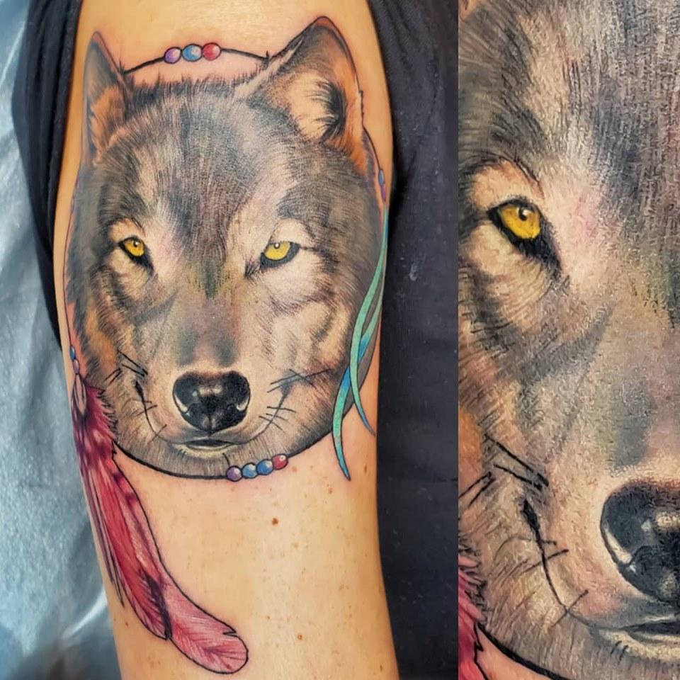 Wolf dreamcatcher by Chico Lou's Fine Tattoos shop in Athens Georgia GA. Artist - Sara Fogle