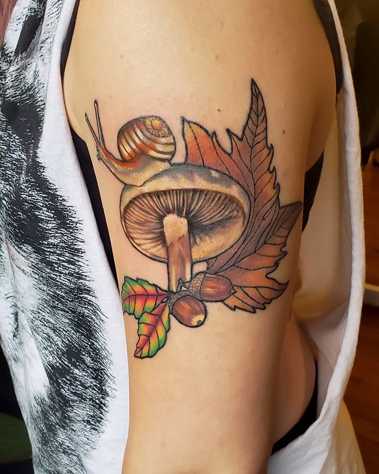 Snail and mushroom by Chico Lou's Fine Tattoos shop in Athens Georgia GA. Artist - Sara Fogle