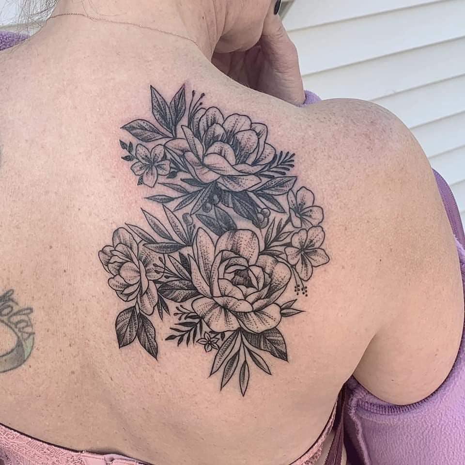 Blackwork flowers by Chico Lou's Fine Tattoos studio in Athens georgia GA. Artist - Veronica Hahn