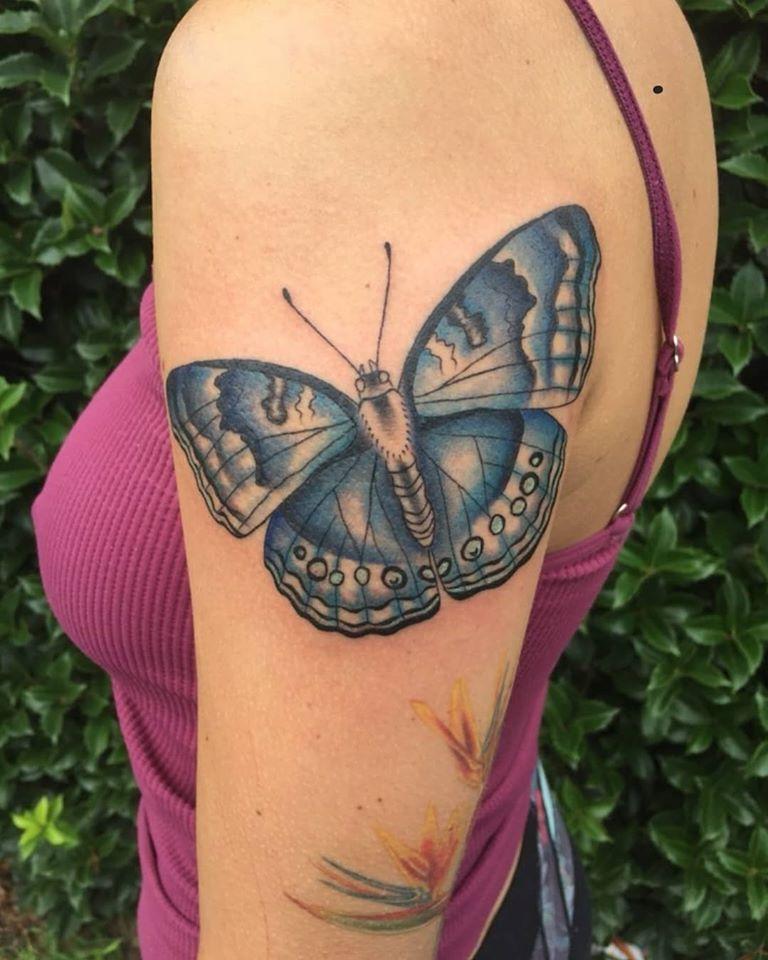 Butterfly by Chico Lou's Fine Tattoos studio in Athens Georgia GA. Artist - Darya Kalantari