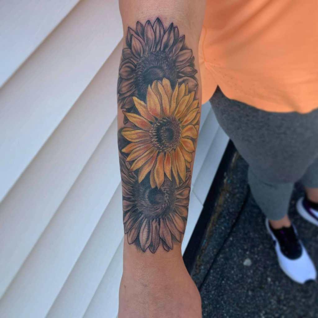 Sunflowers by Chico Lou's Fine Tattoos studio in Athens Georgia GA. Artist - Veronica Hahn