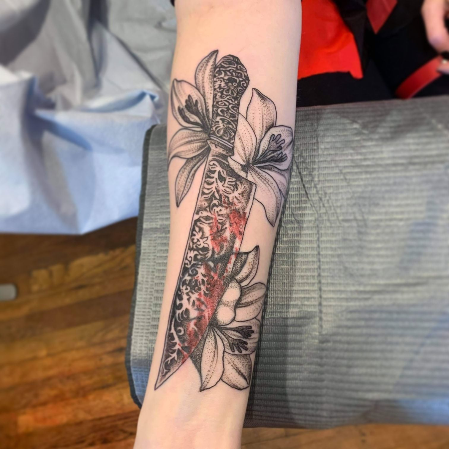 Knife and flowers by Chico Lou's Fine Tattoos studio in Athens Georgia GA. Artist - Veronica Hahn