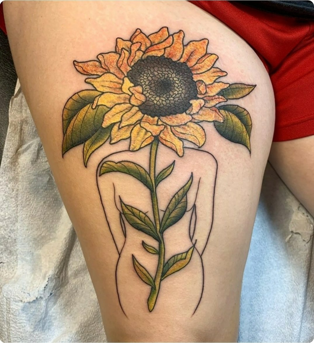 Sunflower lady by Chico Lou's Fine Tattoos studio in Athens Georgia GA. Artist - Darya Kalantari