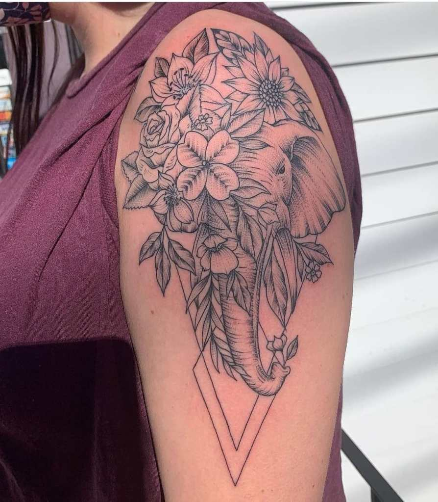 Fine line elephant and flowers by Chico Lou's Fine Tattoos studio in Athens Georgia GA. Artist - Jess Clark
