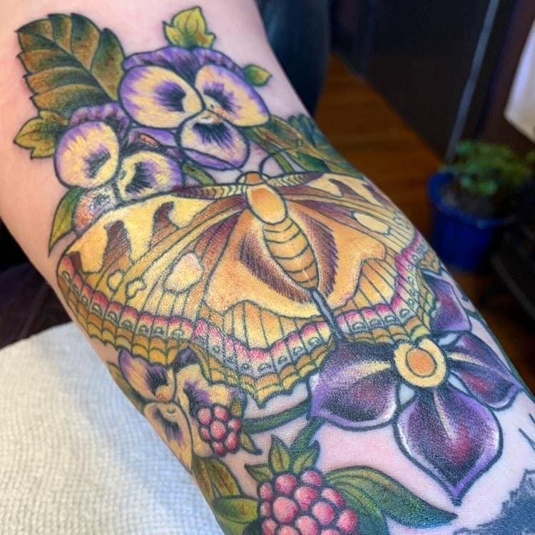 Moth and flowers by Chico Lou's Fine tattoos studio in Athe Georgia GA. Artist - Darya Kalantari