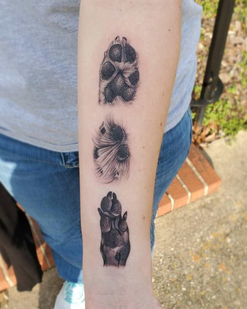 Paw prints by Chico Lou's Fine Tattoos studio in Athens Georgia GA. Artist - Sara Fogle