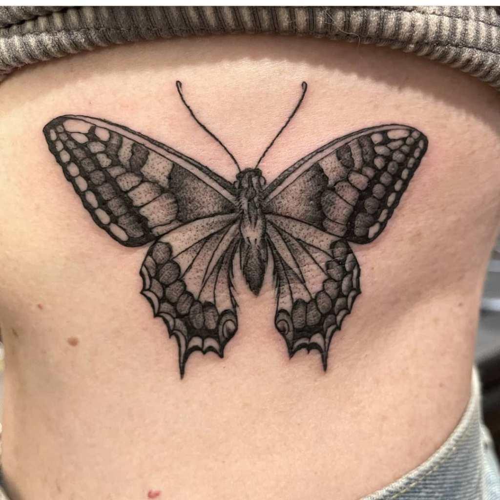 Butterfly by Chico Lou's Fine Tattoos studio in Athens Georgia GA. Artist - Jess Clark